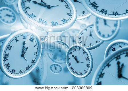 Digitally generated image of clocks against white background