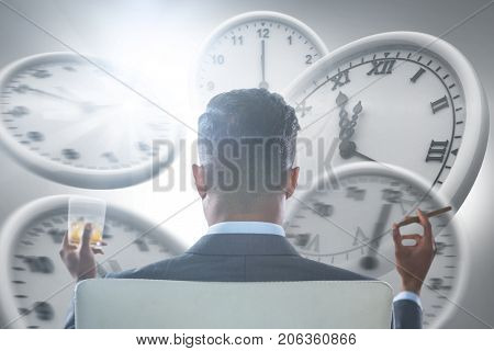 Rear view of businessman holding whisky glass and cigar against computer graphic image of wall clocks