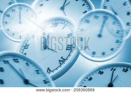 Computer generated image of wall clocks against white background