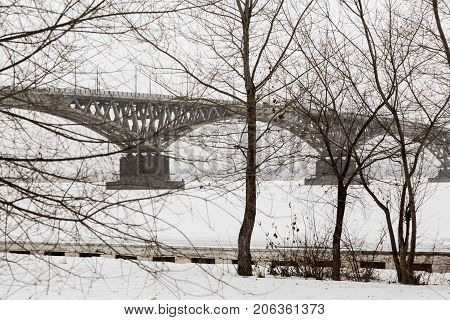Winter cityscape. Bridge across the Volga river between the cities of Saratov and Engels, Russia.