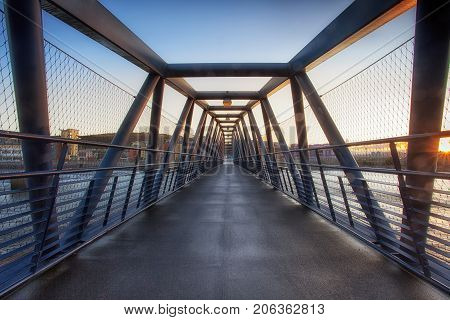 The Trafalgar Bridge is a pedestrian and cycle bridge located at the barrage crossing over the barrage lock on the river Tawe, Swansea, South Wales, UK
