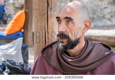 Bald Man Dressed Like Christian Franciscan Friar Or Monk