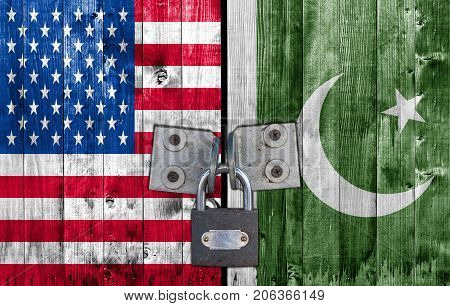 US and Pakistan flag on door with padlock