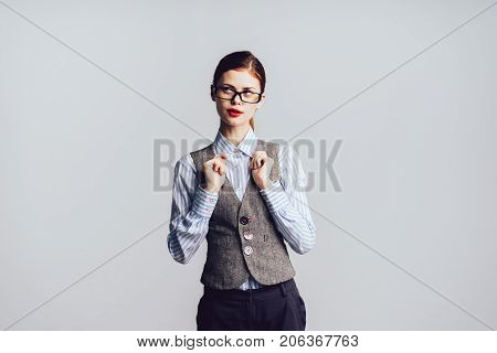 red-haired girl with glasses and costume looks mysteriously to the side, isolated