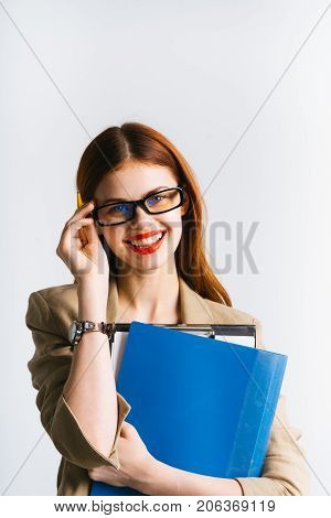 smiling girl with red lipstick and wearing glasses holds a folder with papers on white background isolated