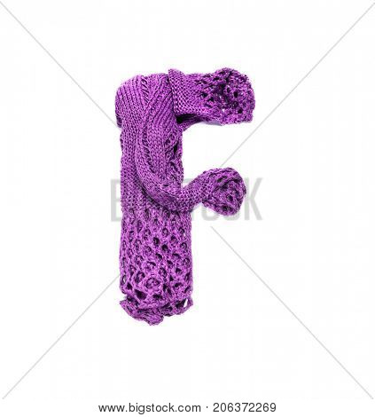 Knitting alphabet. Letter of knit handmade alphabet on white background. Letter F of knit handmade alphabet