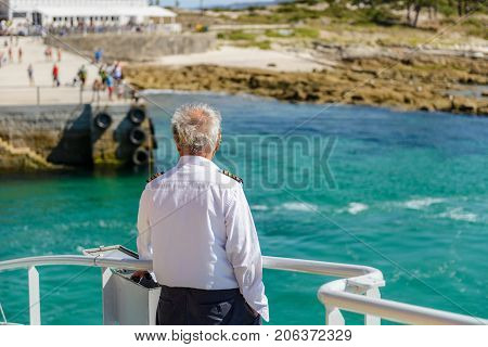 ship captain observes the pier during mooring