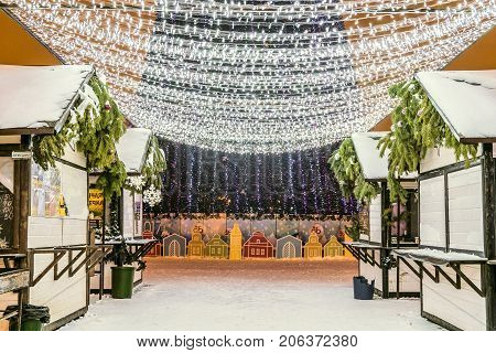 Belgorod Russia - January 8 2017: New Year's Cathedral Square with christmas decorations in Belgorod city. Passage with illuminated LED garlands among the christmas fair pavilions.