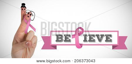 Cropped hand with pink breast cancer awareness ribbon against white background with vignette