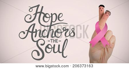 Cropped hand of woman with breast cancer awareness ribbon against neutral background