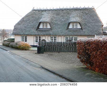 Graasten Denmark - December 23 2007: Thatched House on Winter day in Graasten Denmark
