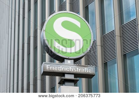 train station sign of S-bhf Friedrichstrasse in Berlin (S-Bahn symbol at Friedrichstr.)