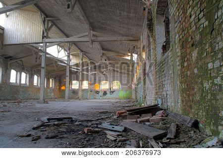 Destroyed warehouse - part of ruined factory hall. Forgotten industrial building.