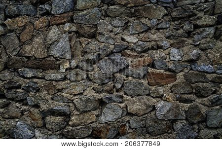 Gray stone wall. Stone background. Stone texture.Old stone style. Grunge stone. Grunge grey stone background. Fragment of wall of an old fortification in Ust-Kamenogorsk. Stone gray background.