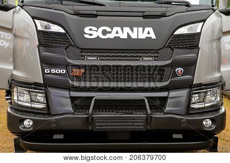HYVINKAA FINLAND - SEPTEMBER 8 2017: The front of Scania G500 XT truck featuring eg heavy duty bumper and headlamp protection mesh. Scania presents their new XT truck range on MAXPO 2017 Finland.