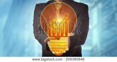 Unrecognizable manager offering a bright idea for sales growth in the shape of a lightbulb with a trend chart for glow wire. Business concept for corporate vision forecasting trending and success.