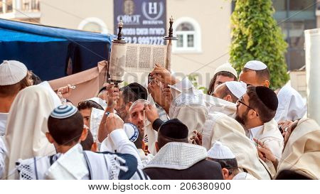 Hasids pray while reading the Torah scroll. Uman Ukraine - 21 September 2017: Rosh Hashanah Jewish New Year. It is celebrated near the grave of Rabbi Nachman in Uman.