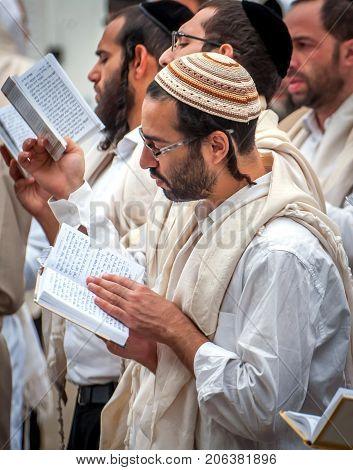 Prayer. Uman Ukraine - 21 September 2017: Rosh Hashanah Jewish New Year. It is celebrated near the grave of Rabbi Nachman. Pilgrims Hasidim on the street of the city of Uman.
