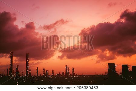 Petrochemical plant view silhouette on sky sunrise View of the petrochemical industry while sunset