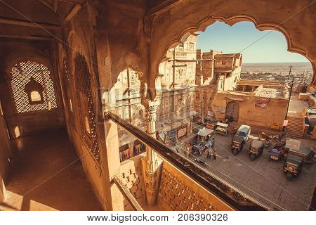 JAISALMER, INDIA - FEB 1, 2016: Old city view from carved balcony of the historical indian home on February 1, 2016. Jaisalmer has a population of about 78000.