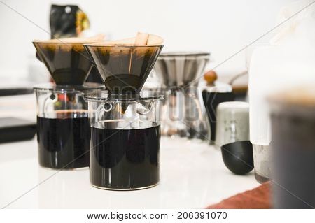 Coffee drip set on coffee bar.Ground coffee beans contained in a filter.