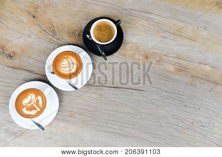 Three Coffee Cup With Latte Art Rose Flower Shape In The First Cup Another Cup Is Hearth And Leaf Pa