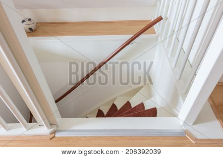 White Wooden Stairs With Red Mats