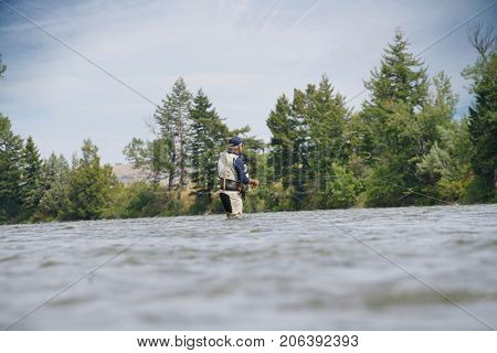 Fly-fisherman fishing in the Gallatin River, Montana