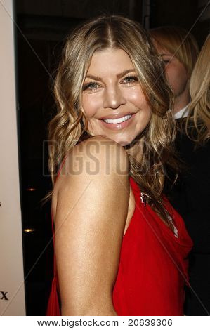 SANTA MONICA - APR 9: Fergie aka Stacy Ferguson arriving at the American Red Cross, Santa Monica Chapter's Annual Red Tie Affair in Santa Monica, California on April 9, 2011