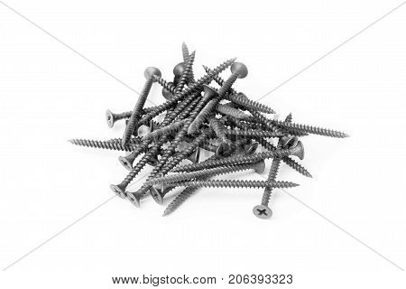 a pile of black screws isolated on white background