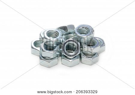 a bunch of steel hex nuts isolated on white background