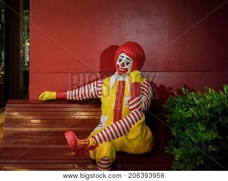 BANGKOK THAILAND - July 24: Local McDonald's Franchise Displays a statue of Ronald McDonald sitting on a bench on July 24 2017 in Bangkok