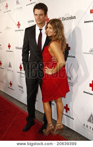 SANTA MONICA - APR 9: Josh Duhamel, wife Fergie aka Stacy Ferguson arriving at the American Red Cross, Santa Monica Chapter's Annual Red Tie Affair in Santa Monica, California on April 9, 2011