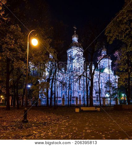 Night autumn view of illuminated St. Nicholas Naval Cathedral and Nikolskiy garden St. Petersburg Russia