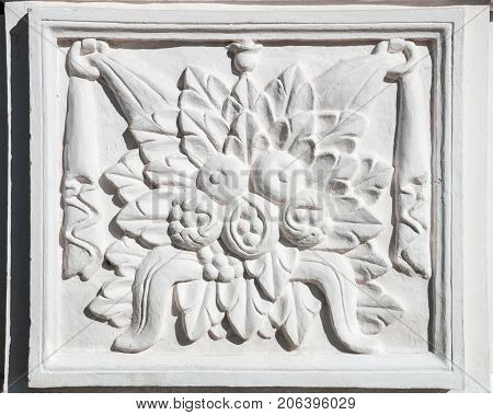 Ancient rectangular bas-relief with floral ornament completely framed