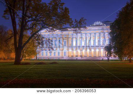 Night autumn view of Mikhailovskiy Garden and illuminated State Russian Museum Saint Petersburg Russia