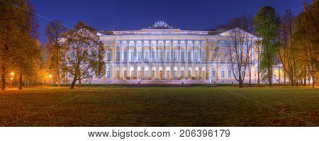 Night panoramic autumn view of Mikhailovskiy Garden and illuminated State Russian Museum Saint Petersburg Russia