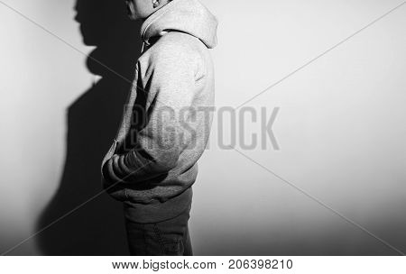 the guy in the blank grey hoodie sweatshirt stand