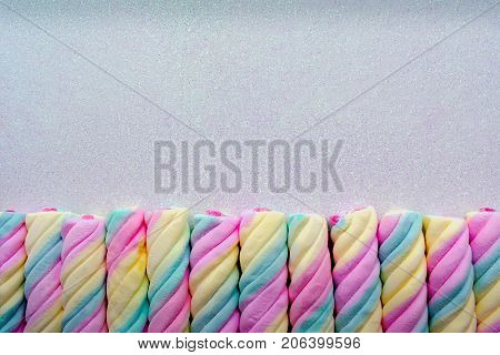 Colorful Twisted Marshmallows Lined up in a Row