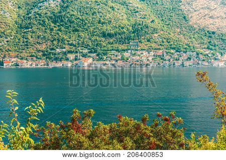 View of the city of Perast on the other side of the Bay of Kotor, Montenegro.  Perast traditional balkan village mountain landscape by kotor bay in montenegro.