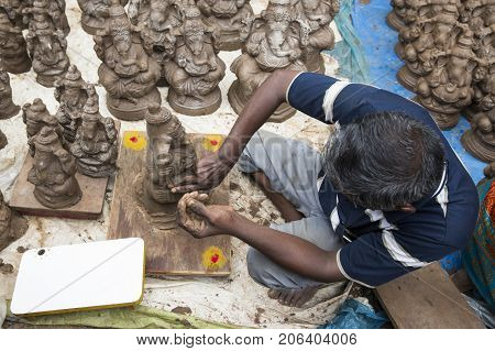 Close up of hand crafted Ganesha idol clay statues displayed in the market during Ganesh Festival.