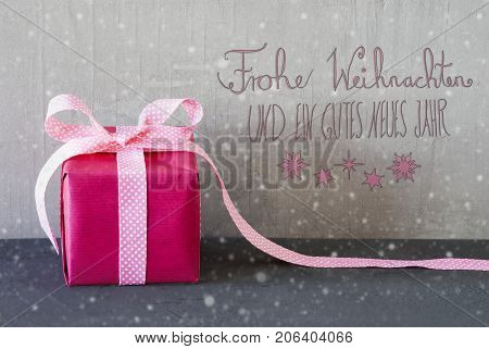 Gray Grungy Cement Wall With German Calligraphy Frohe Weihnachten Und Ein Gutes Neues Jahr Means Merry Christmas And Happy New Year. Pink Gift Or Present With Bow And Snowflakes.