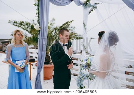 Bride And Groom Make Wedding Vows At The Ceremony