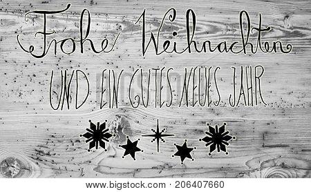 Black German Calligraphy Frohe Weihnachten Und Ein Gutes Neues Jahr Means Merry Christmas And Happy New Year. Gray Vintage Wooden Background