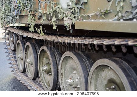 Part of undercarriage tracked military equipment closeup