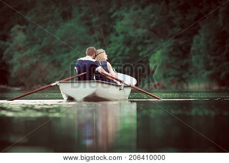 tender couple hugging on lake, people have holiday on river, romantic couple have quite vocation on nature