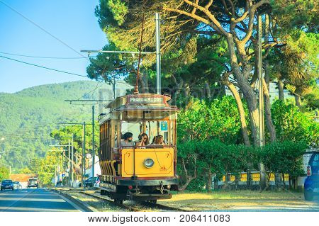 Lisbon, Portugal - August 9, 2017: Tram 7 running from Sintra to Praia das Macas. The Sintra tramway, in Portuguese, Eletrico de Sintra, is a popular historic runway with summer races.