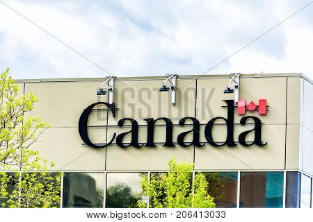 Saguenay, Canada - June 3, 2017: Closeup Of Canada Sign On Building In Quebec Saguenay City, Canada