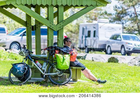 Levis, Canada - June 4, 2017: Male Person, Man With Bicycle At Rest Area Stop By Highway In Quebec P