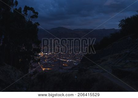 Panoramic View Of Cusco Town With Glowing City Lights At Dusk. Cusco Is Among The Most Touristy Trav